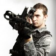 Young soldier aiming — Stock Photo