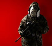 Young soldier with mask — Stock Photo