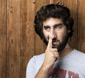 Man with finger in nose — Stock Photo