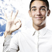 Young man doing ok symbol — Stock Photo