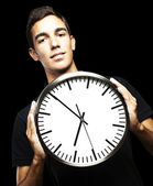 Young man and clock — Stok fotoğraf