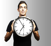 Young man and clock — Stock Photo