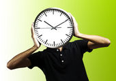 Young man with clock — Stock Photo