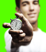 Man pushing stopwatch button — Stockfoto