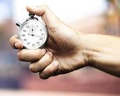 Cronometro holding mano — Foto Stock