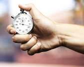 Hand holding stopwatch — Stock Photo