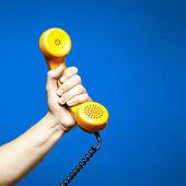 Hand holding telephone — Stock Photo