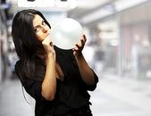 Woman blowing balloon — Stock Photo