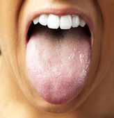 Woman showing the tongue, closeup — Stock Photo