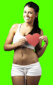 Woman holding heart symbol — Foto Stock
