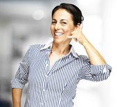 Woman gesturing telephone — Stock Photo