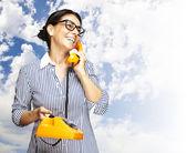 Woman talking on telephone — Stock Photo