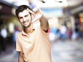 Man gesturing success symbol — Stock Photo