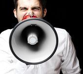 Muž s megafon — Stock fotografie
