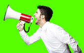 Man shouting with megaphone — Stock Photo