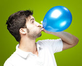 Man blowing balloon — Stock Photo