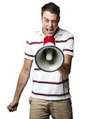 Uomo gridando con il megafono — Foto Stock