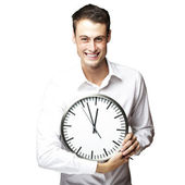 Man holding clock — Stock Photo