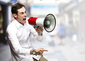 Man with megaphone — Stockfoto