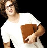Muž hospodářství knihy — Stock fotografie