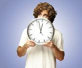 Man hidden behind clock — Stock Photo