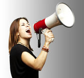 Girl with megaphone — Stock Photo