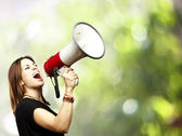 Woman using megaphone — Stock Photo