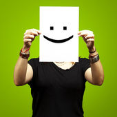 Woman with smile emoticon — Stock Photo
