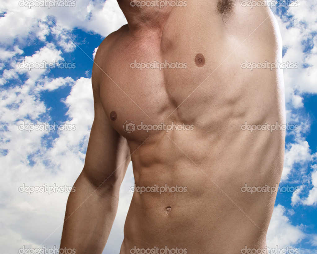 Strong torso of young man with a cloudy sky as a background — Stock Photo #10171032