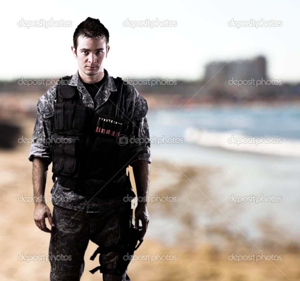 Young soldier near the sea shore — Stock Photo #10172274
