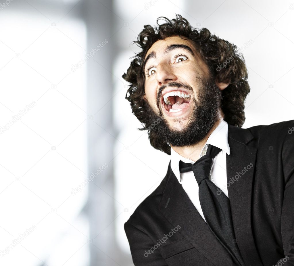 Portrait of young man wearing suit laughing indoor — Stock Photo #10173578