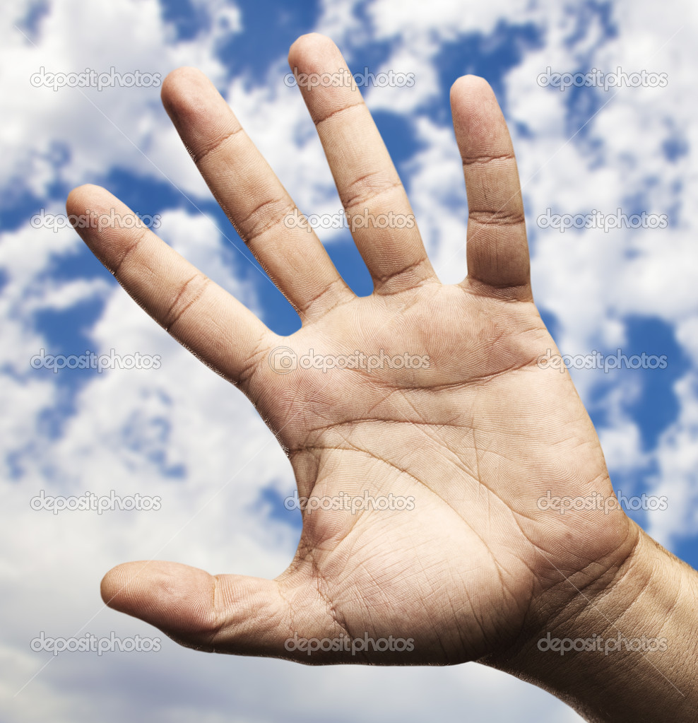 Hand symbol against a blue sky background — Stock Photo #10175037