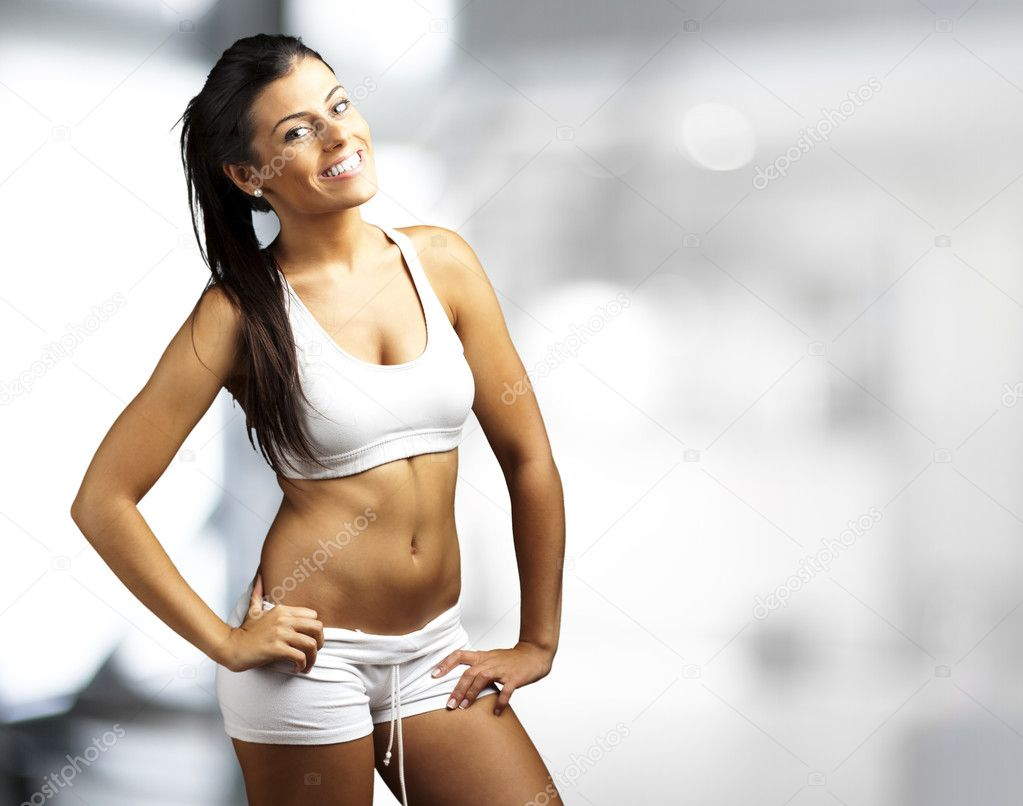 Portrait of a pretty sporty woman indoor  Stock Photo #10176808