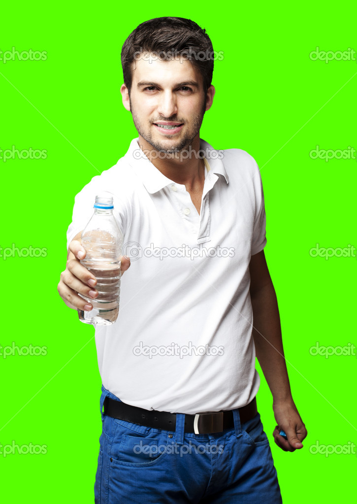 Portrait of a young man offering a water bottle — Stock Photo #10178466