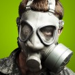 Soldier with gas mask - Stock Photo