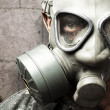 Stock Photo: Soldier with gas mask