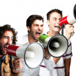 Young shouting with megaphone over white background — Stockfoto #10180131