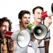 Young shouting with megaphone over white background — Stockfoto