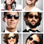 Young enjoying wearing sunglasses over grey background — Stock Photo