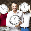 Students holding clock — Stock Photo #10180282