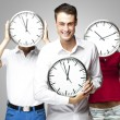 Students holding clock — Stockfoto