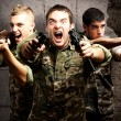 Tree soldiers aiming — Stock Photo