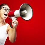 Woman shouting using megaphone — Stock Photo