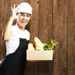 Woman carrying food - Stock Photo