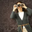 Woman with binoculars — Stock Photo #10180895