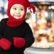 Portrait of an adorable kid smiling wearing winter clothes — Stock Photo #10181042