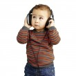 Portrait of a handsome kid listening to music looking up over wh — Stock Photo
