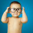 Portrait of funny kid shirtless wearing glasses over blue backgr — Stock Photo