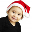 Portrait of happy kid wearing a christmas bonnet over white back — Stock Photo #10181520