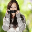 Stok fotoğraf: Portrait of scared girl being silenced by herself against natu